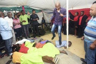 [VIDEO] South African Pastor asks members to go NAKED while Praying,Jumps on them while Praying