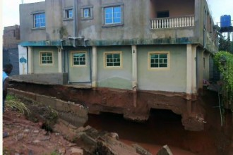 [PHOTO NEWS] Anambra State Mansion swept Away by Flood,Owner threatens to commit suicide