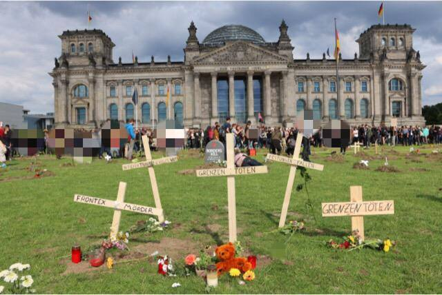 [BREAKING] Demonstrators in Germany invades Parliament ,digs over 100 Graves to mourn Dead Refugees(PHOTOS)