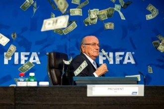 FIFA President Sepp Blatter sprayed with Dollars by British comedian Simon Brodkin