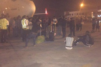 [PHOTO NEWS] Anarchy at Abuja Airport as passengers take over run way,stops Turkish Airline from taking off