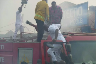 [PHOTO NEWS] Gov.Fayose joins firefighters to tackle burning petrol station