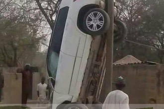 [PHOTO NEWS] Jeep left Hanging on an Electric Pole,after an accident in Sokoto Road,Kano