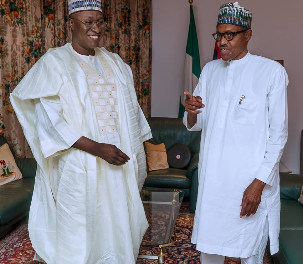 PDP Gombe Bigwig Decamps To APC, Poses With Buhari
